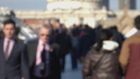 People on Millennium Bridge - blurred scene - LONDON, ENGLAND Footage