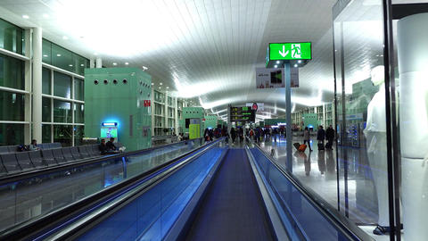 FPV move at travelator, BCN terminal interior at early morning, departure gates Footage