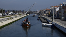 Tourists on Moliceiro traditional canal boats in Aveiro Portugal Footage