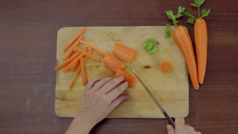 Bird's eye view, close-up of professional cook chopping carrots on cutting board 영상물