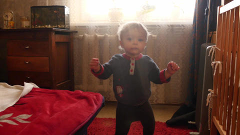 cute toddler stepping in vintage decor room against flickering sun 2 Footage