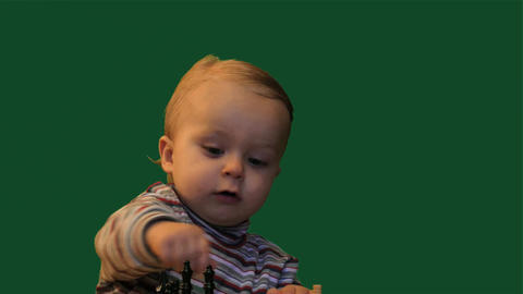 1 years old baby near table with chess green screen background dolly shot Footage