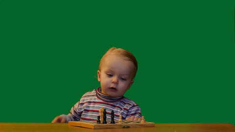 cute 1 year old baby bite an apple smooth dolly shot green screen Footage