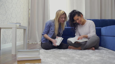 Two beautiful students prepares to exams at home Footage