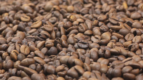 Rotation of the background of whole beans of coffee. Close-up Footage