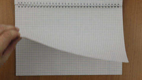 Hand quickly turns over the notepad sheets, for advertising and your text Footage