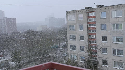 Snow falling in front of the living block of flats. Living flats in winter Footage