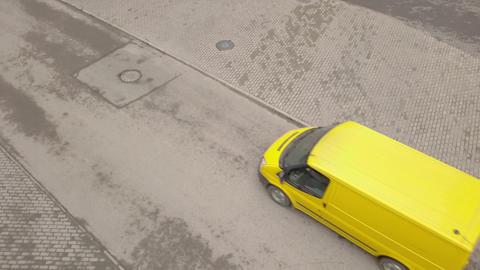 Yellow minibus moving along asphalt road. Yellow passenger van driving on road Footage