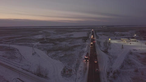 Petrol tanker with flashers standing on roadside on winter highway aerial view Footage