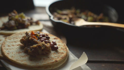 Tortilla and fry pan with fillings. Video 영상물
