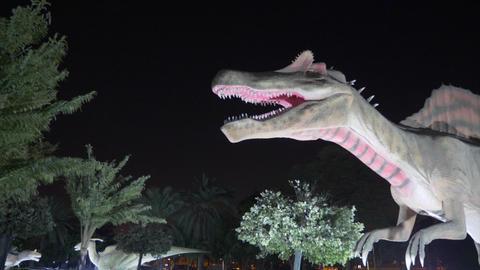 Dubai, UAE - January 13, 2018: frightening figure predatory Spinosaurus dinosaur Footage