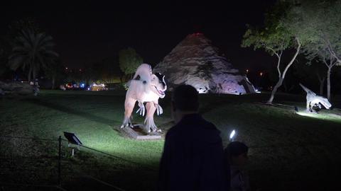 Dubai, UAE - January 13, 2018: people looking at figure Spinosaurus dinosaur ビデオ