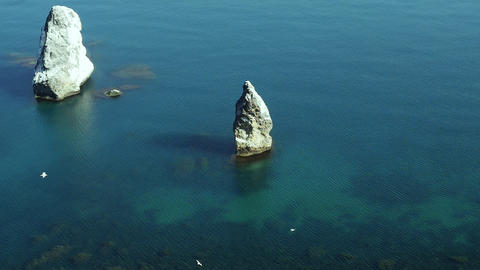 Beautiful view of crags in calm blue sea from mountain Footage
