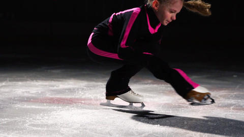 A professional little figure skater at the figure skating competitions performs Live Action