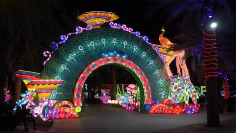 Dubai, UAE - January 13, 2018: luminous arch with decorative multicolored Live Action