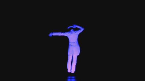 Neon show, colorful men dancing on a black background Live Action