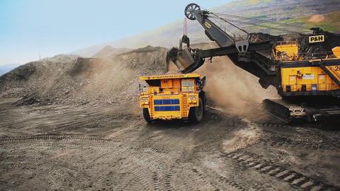 Excavator loads the machine on a career Footage