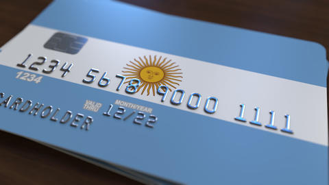 Plastic bank card featuring flag of Argentina. National banking system related Live Action