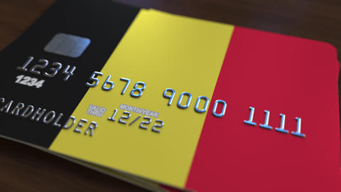 Plastic bank card featuring flag of Belgium. National banking system related Live Action