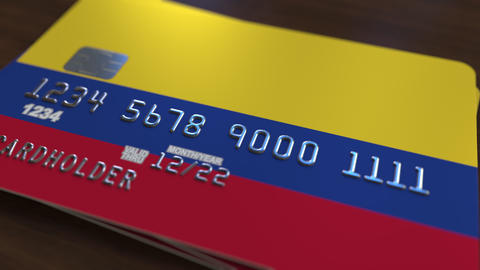 Plastic bank card featuring flag of Colombia. National banking system related Footage