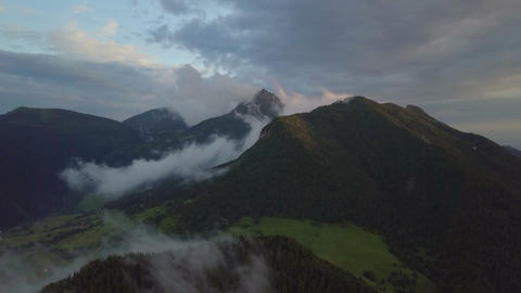 Evening flight over misty forest in mountains Footage