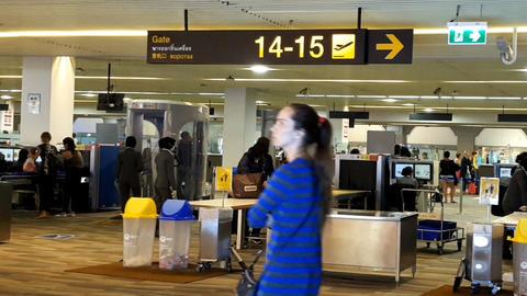 Phuket, Thailand- Febuary 18, 2018: Passengers pass through X-ray screening in Footage