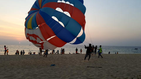 Tourists on parasailing at Karon beach in the evening 영상물