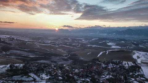 Aerial view of sunset over low land country and small village. Hyper time lapse Footage