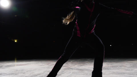 Professional girl skater moves on ice on skates with legs unfolded to the sides Footage