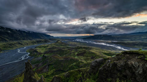 Dramatic evening over volcanic mountains in Iceland. Time lapse Footage