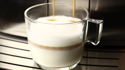 Espresso added to milk froth making latte coffee Live Action