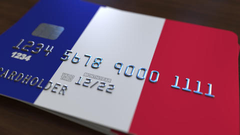 Plastic bank card featuring flag of France. National banking system related Footage