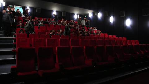 People Filling Cinema Timelapse Footage