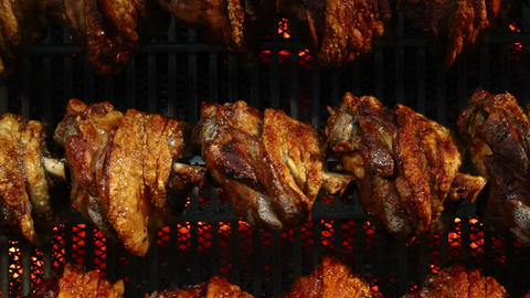 Pork knuckles slowly cooked at rotation grill ビデオ