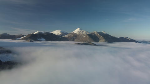 Fly above foggy clouds in winter mountains. Hyper lapse Live Action