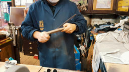 Madrid, Spain - February 1, 2018: Blue collar worker man in a blue apron wearing 영상물