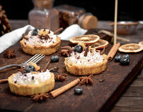 cakes with white cream and sprinkled with chocolate Photo