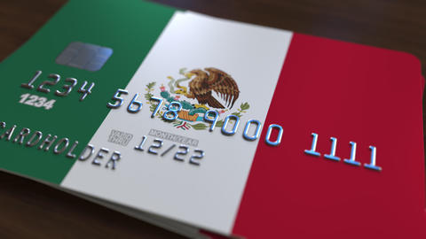 Plastic bank card featuring flag of Mexico. National banking system related Footage