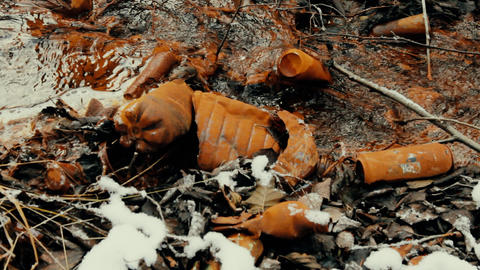 Plastic bottles and cans in creek covered with red patina iron Footage