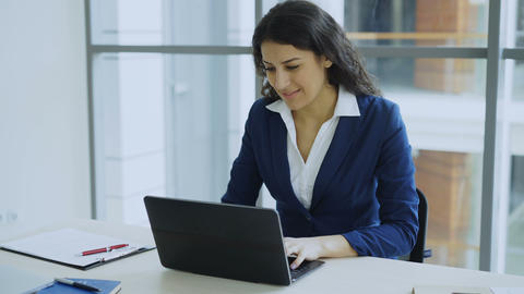 Young businesswoman using laptop computer receiving good message and become very Footage