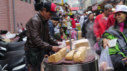 Steamed black sugar Chinese cake on street traders stall Taipei Taiwan Footage