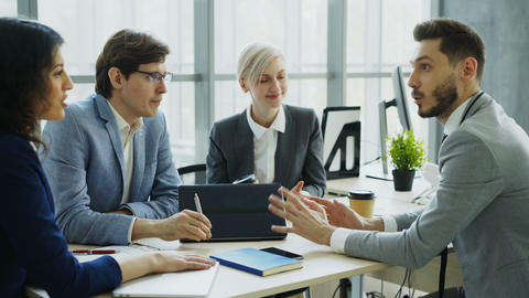 Businessman discussing future business project with male and female colleagues Footage