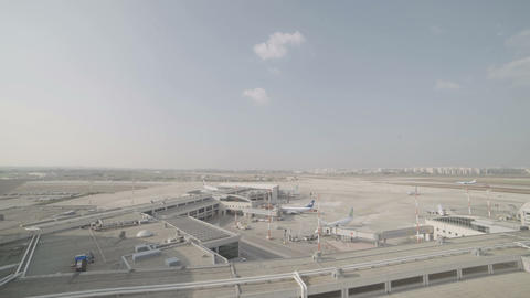 Overview of a large airport with planes and terminals Footage