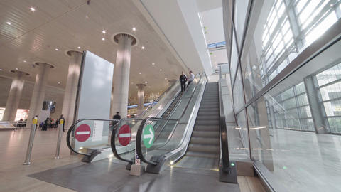 Timelapse of people riding escalators in the airport terminal Footage