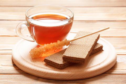 Hot black tea with chocolate waffles and sugar sweetener Photo