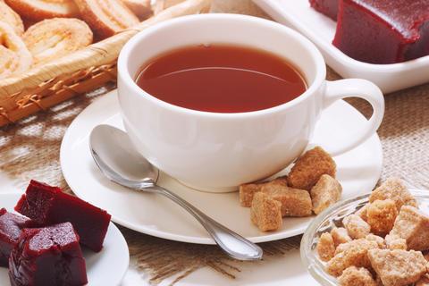 English tea with cane sugar and cherry jam Photo