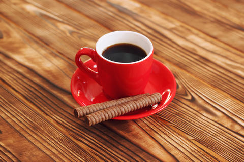 Cup of coffee with waffle tubes Photo