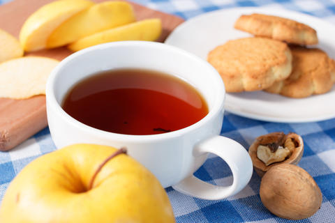 Apple with cup of tea composition Photo