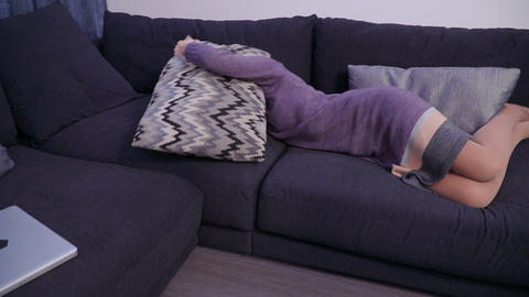 Tired woman covers with a pillow and wants to be left alone after hard work day Footage
