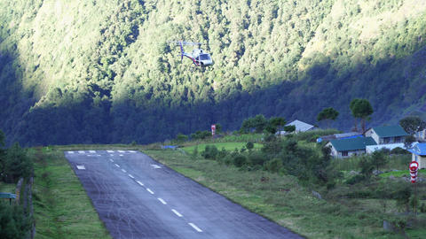 Helicopter lands on deck in Lukla TenzingHillary Airport Footage